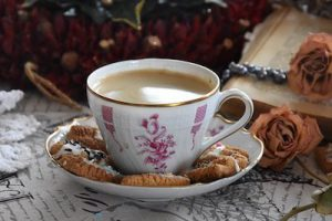 Afbeelding van een kopje koffie met koekjes